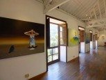 Painting in the gallery's bright exhibition room