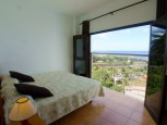 Bed with a view of the Mirador apartments in the Valle Gran Rey