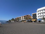 Fine-sandy beach and promenade in La Playa in Valle Gran Rey